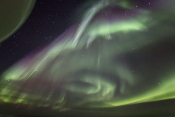 Northern lights above the central Arctic Ocean. This image was taken during an expedition of the German research icebreaker