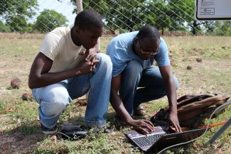 Collecting climate data at a WASCAL climate station, Dano catchment, Burkina Faso