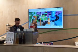 Coffee bar in the German pavilion. The screen showed funding measures of the BMBF.