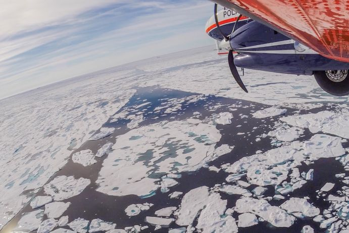 Polar 6 research aircraft of Alfred Wegener Institute flies over Arctic Ocean during IceBird sea ice thickness campagne.