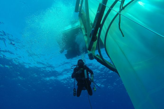 A diver next to a mesocosm off the coast of Gran Canaria.