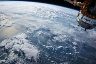 A satellite observes the Earth from space